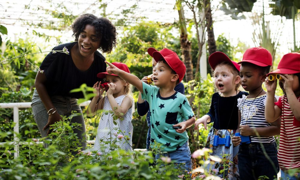 Teacher and kids school learning ecology gardening